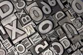 Random arrangement of letterpress lead letters — Stockfoto