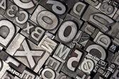 Arrangement aléatoire de lettres de plomb typographique — Photo