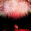 Fireworks on the lake on water - Stock Photo