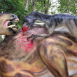 Realistic scene of two dinosaurs hunting — Stock Photo