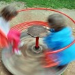 Stock Photo: Red children carousel spinning round