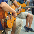 Постер, плакат: Street performers with guitar