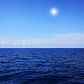 Blue sea and blue sky background — Stock Photo