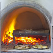 Brick pizza oven with fire — Stock Photo