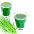 Wheat grass juice on white background — Stock Photo #48517701
