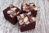 Almond brownie on old wood — Stock Photo