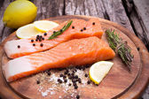 Close up Fresh salmon with spices on old wood  — Stock Photo