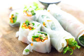 Portion of spring rolls on wood — Stock Photo