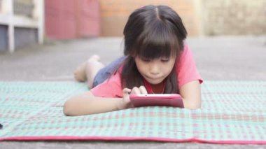 HD Dolly: Little Asian girl touching tablet computer surface touchscreen ipad — Vídeo Stock
