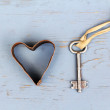 Stock Photo: Heart and key on wooden background