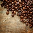 Coffee on grunge wooden background — Stock Photo #16175013
