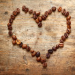 Coffe heart on old wooden background - Stock Photo