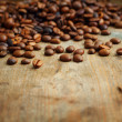 Coffee on grunge wooden background - Stock Photo