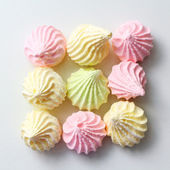 Pastel colored meringue background — Stock Photo