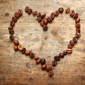 Coffe heart on old wooden background — Stock Photo