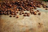 Café sobre fondo de madera grunge — Foto de Stock