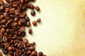 Coffee on old paper background — Stock Photo