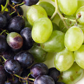 Green and blue grapes — Stock Photo