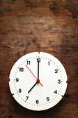 Clock on wooden background — Stock Photo