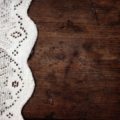 Weaved tablecloth on wooden background — Stock Photo