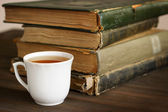 Cup of tea and old books — Stock Photo