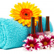 Turquoise towel, nail polish, gerbera — Stock Photo