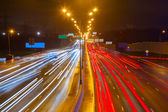 Traffic on the highway at night — Stock Photo