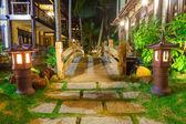 Wooden bridge in the light of lanterns — Stock Photo