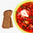 Rye bread and plate with borsch — Stock Photo #27051967