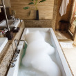 Stock Photo: Hot relaxing bath with floral aromand foam