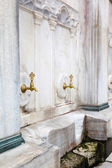 Old faucet in marble — Stock Photo