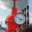 Stock Photo: Manometer, red valve on hot pipe