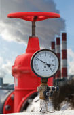 Manometer, red valve on hot pipe — Stock Photo