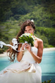 Wedding bouquet and groom — Stock Photo