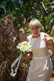 Wedding bouquet and girlfriend of bride — Stock Photo