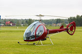 Small private helicopter on grass — Stock Photo