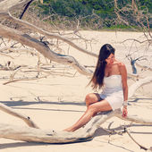 Girl in a dress on the dry tree — Stock Photo