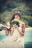 Wedding bouquet and groom — Stock Photo
