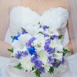 Stock Photo: Wedding bouquet in hands of bride