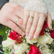 Stock Photo: Hands of newlyweds with rings