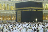 A close up view of Muslim pilgrims circumambulate the Kaaba from ground floor of Haram Mosque, Mecca. — Stock Photo