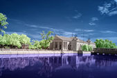 Infrared photo of ancient building with reflection. — Stock Photo