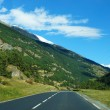 Постер, плакат: Empty road with blue sky inside Switzerland