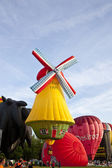 BARNEVELD, THE NETHERLANDS - 17 AUGUST 2012: Colorful windmill and red air — Stock Photo