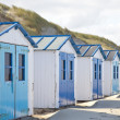 Stock Photo: Dutch little houses on beach in De Koog Texel, Netherlands
