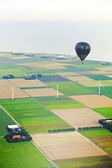 Hot air balloon with Dutch agricultural landscape — Stock Photo