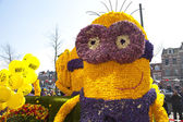 HAARLEM, THE NETHERLANDS - APRIL 21 2013: Despicable character with flowers at flower parade on April 21 2013 in Haarlem, The Netherlands. The annual flower parade is a unique event with one million v — Stock Photo