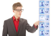 Young man selecting virtual friends isolated on white background — Stock Photo