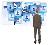 Young man looking at his virtual friends isolated on white background — Stock Photo