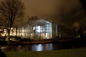 AMSTERDAM, THE NETHERLANDS: Hortus Botanicus Amsterdam Building with lights at annual Amsterdam Light Festival on December 30, 2013. Amsterdam Light Festival is a winter light festival — Stock Photo